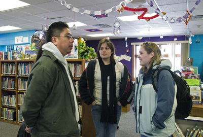 Kirby Metoxen, UW student Rae Funmaker and SLIS student Christina Johnson at Oneida Community Library.